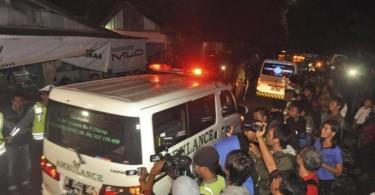 Ambulances take away the bodies of the executed prisoners away from the coastal town of Cilacap, off Nusakambangan island.