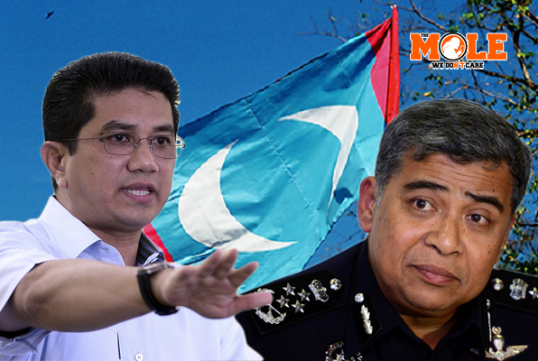 There's Azmin (left) and police chief Khalid.