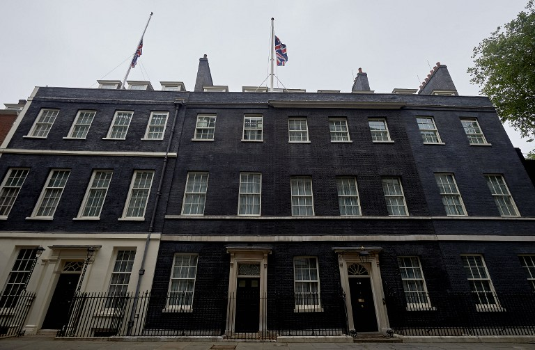 Flags at half-mast over 10 Downing Street to mourn the victims of the massacre in Tunisia. -- AFP photo by Niklas Hallen.