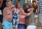 Foreign tourists console each other moments after the attack on a popular Tunisian beach.