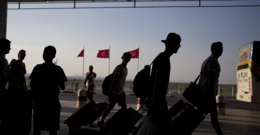 Foreign tourists arrive at an international airport in Tunisia to leave the country after a massacre that left 38 people dead. -- AFP photo by Kenzo Tribouillard.
