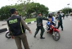 Religious police in Aceh stop a girl for wearing tight jeans.