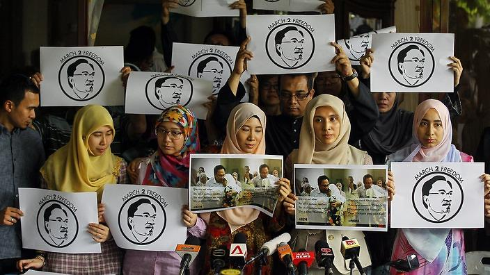 Anwar's five daughters (front) at one protest event.
