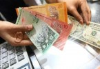 At close today the ringgit breached the psychological level of 4 to 1 US dollar.