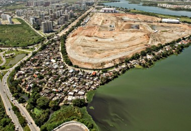 Whatever little is left of Vila Autodromo as construction of the Olympic Park (cleared site; right background) takes place.
