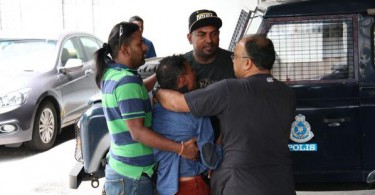 Relatives of Morais at the hospital where his body was taken to.