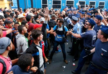 These mainly Middle-Eastern migrants face off with Hungarian police after the main Eastern Railway station in Budapest was closed to prevent them from travelling further into Austria and Germany.