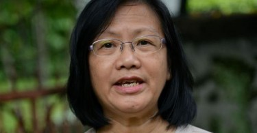 Maria Chin was charged with seven others.