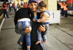 This refugee and his two exhausted young children finally arrive in Germany to what would hopefully be a new life away from conflict for his family.