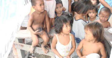 Malnutrition is a big issue in the Philippines. Here children from under-privileged backgrounds wait for food assistance.