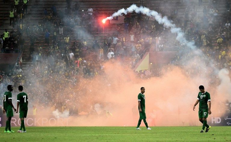 Sher madness at the Shah Alam Stadium as Malaysian fans rained flares and fire-crackers onto the pitch near the end of the match.