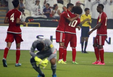 Jubilation for the UAE players and dejection for the Malaysian goalkeeper. -- AFP photo