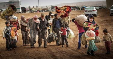 Syrian refugees cross into Turkey after fleeing the civil unrest in their country. -- Photo by Zohra Bensemra