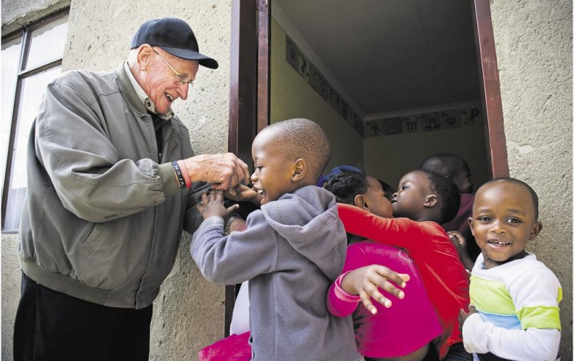 Vlok meeting black kids on one of his regular visits to a township as part of his personal redemption.