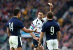Joubert shows a yellow card to Scotland's Sean Maitland (14) in a decision most thought was harsh. -- Photo by Getty Images