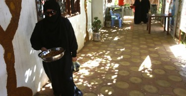 Syrian women cook in the kitchen that is  a project meant to assist  Syrian refugees in Khartoum fleeing the war in their country. -- AFP photo by Ashraf Shazly