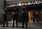 Soldiers stand guard outside the Brussles train station as the city goes on high alert against possible terrorist attacks. -- AFP photo