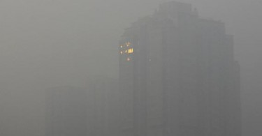 Not an uncommon sight in Beijing. This is what air pollution does to the city and some other major cities in China. -- Photo by Wang Zhao/AFP/Getty Images