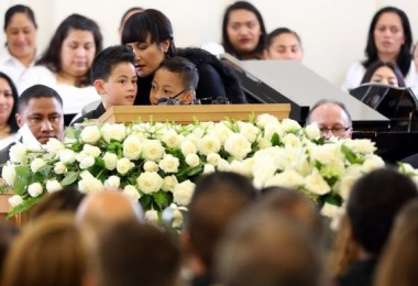 Lomu's widow Nadene with their two sons at his funeral service. -- Photo by Michael Bradley/AFP/Getty Images