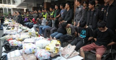 A Bangkok Post photo showing some of the suspects and the drugs seized.