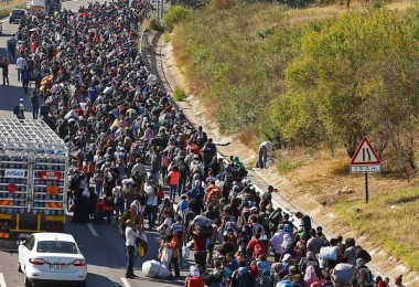 Migrants walking on a road in Turkey towards the border with Greece. -- Reuters photo