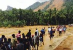 Villagers move to safer areas soon after the massive landslide (background, on hillslope).