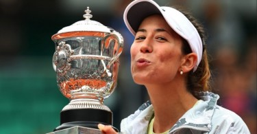 Muguruza with the Suzanne Lenglen trophy that comes with the title.