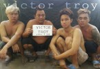 """The four abducted sailors. """"Victor Troy"""" in the sign refers to a Facebook account under the name """"Victor Troy Poz"""", where the image was first loaded."""