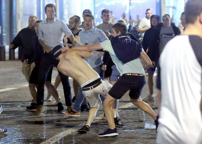 A FlameFlyNet photo shows football fans having a go at each other in Marseille where England played Russia.