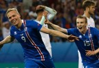 Kolbeinn Sigthorsson (left) celebrates after scoring Iceland's second and winning goal.