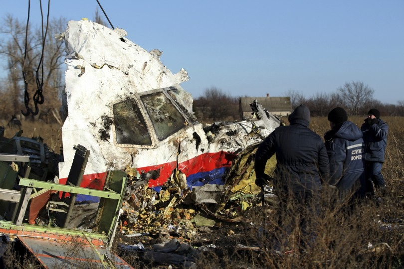 Investigators combing the site in eastern Ukraine where MH17 crashed after it was believed to have been shot by a missile while en route from Amsterdam to Kuala Lumpur.