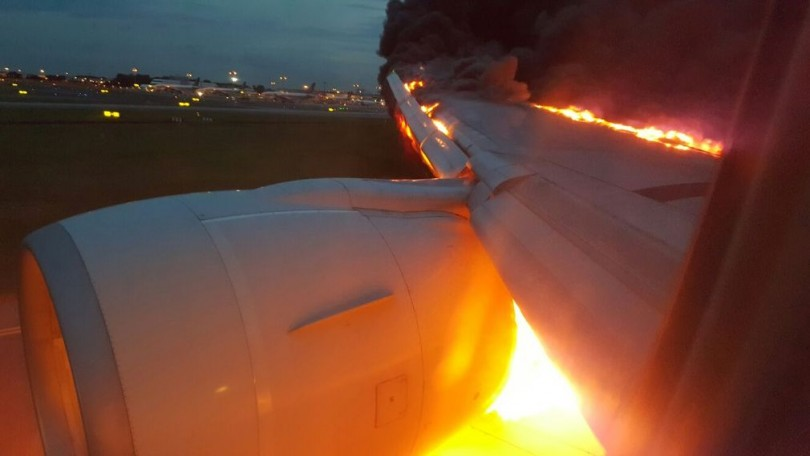 A picture by a passenger inside the Boeing 777-300ER showing the engine catching fire upon landing at Changi International Airport.
