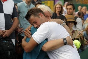 Willis embraces his mother after his upset of upsets at Wimbledon.