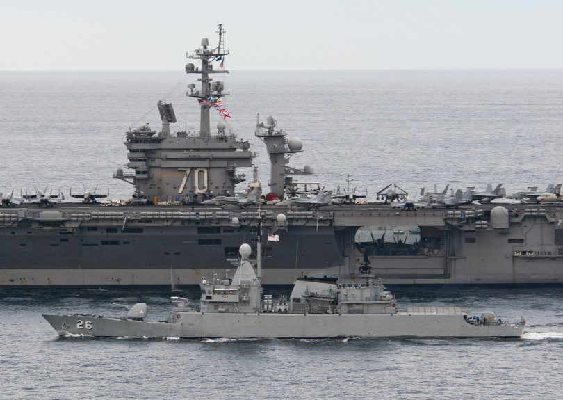 The Nimitz-class aircraft carrier USS Carl Vinson (CVN 70) leads the Royal Malaysian Navy frigate KD Lekir (FF 26) during a passing exercise. Carl Vinson and Carrier Air Wing 17 were underway on a deployment to the U.S. 7th Fleet area of responsibility in the Far East in January 2011.