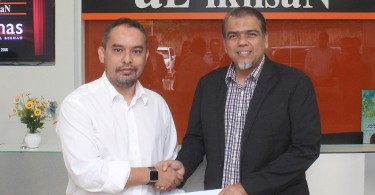From left, Ekuinas CEO Syed Yasir Arafat Syed Abdul Kadir and Al-Ikhsan founder Ali Hassan Mohd Hassan at the signing ceremony.