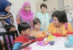 Rosmah with children with autism at Permata Kurnia  Centre in Kuala Lumpur