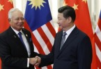 Malaysia's Prime Minister Najib Razak shakes hands with China's President Xi Jinping, during a meeting at the Great Hall of the People, on the sidelines of the Asia Pacific Economic Cooperation (APEC) meetings, in Beijing