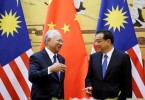 Malaysia's PM Najib Razak and China's Premier Li Keqiang attend a signing ceremony in Beijing