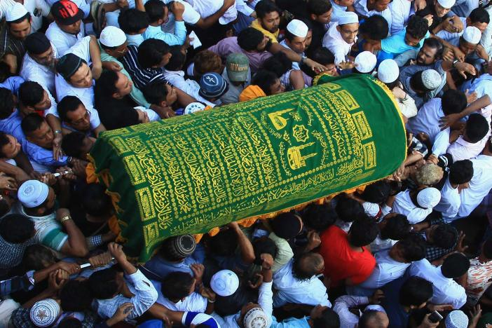 Mourners carry the coffin of Ko Ni, a prominent member of Myanmar's Muslim minority and legal adviser for Myanmar's ruling National League for Democracy.