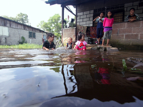 For children, the floods  are a good time to have fun.