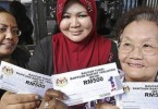 Faces that tell the whole story. This was a photo from the 2012 aid. The highest amount to be given this year should be RM1,200.