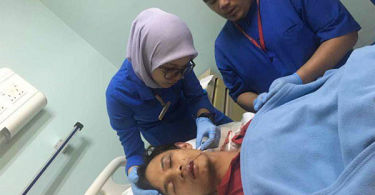The victim, who was identified as Nasrul Faiz Zulfahmi suffers serious injuries at his head and upper torso.