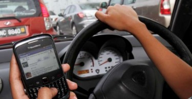Using the handphone while driving is definitely an offence under Kejara.