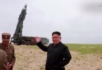 North Korean leader Kim Jong Un checking one of his ballistic missiles