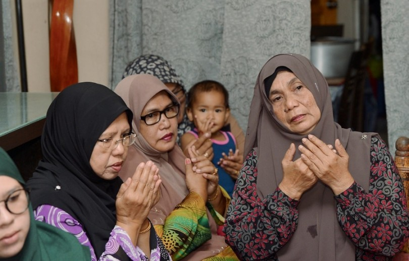 The prayers of Maznah Adan (right), mother to Iza Karmila Mary Ramli, wife of an officer at the Malaysian embassy in Pyongyang, have been answered. Her daughter can now return home safely.