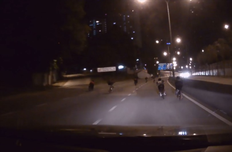 A snippet of a video shows joyriders on the public road doing dangerous stunts with their modified bikes.