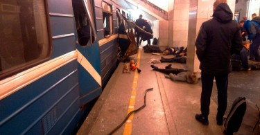 Victims of the blast lying on the platform before help arrives.