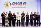 ASEAN leaders link arms during the opening ceremony of the 30th ASEAN Summit in Manila