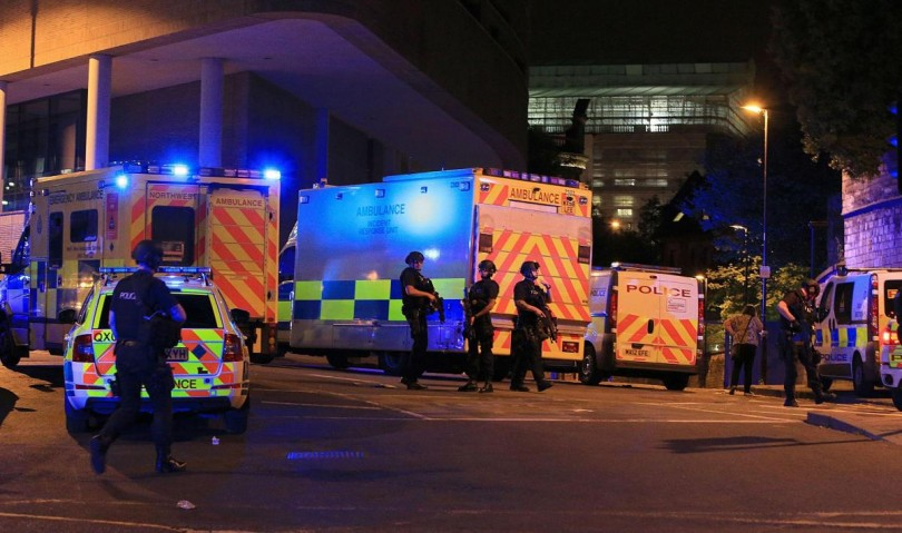 Police secure the area after a recent bomb blast at the end of an Ariana Grande concert at the Manchester Arena.