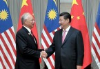 Chinese President Xi Jinping (right) meets with Malaysian Prime Minister Najib Razak in Beijing